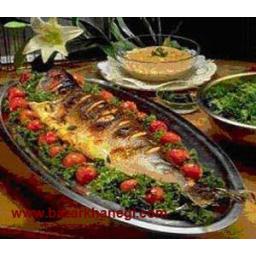 ماهی شکم پر با سبزی محلی
